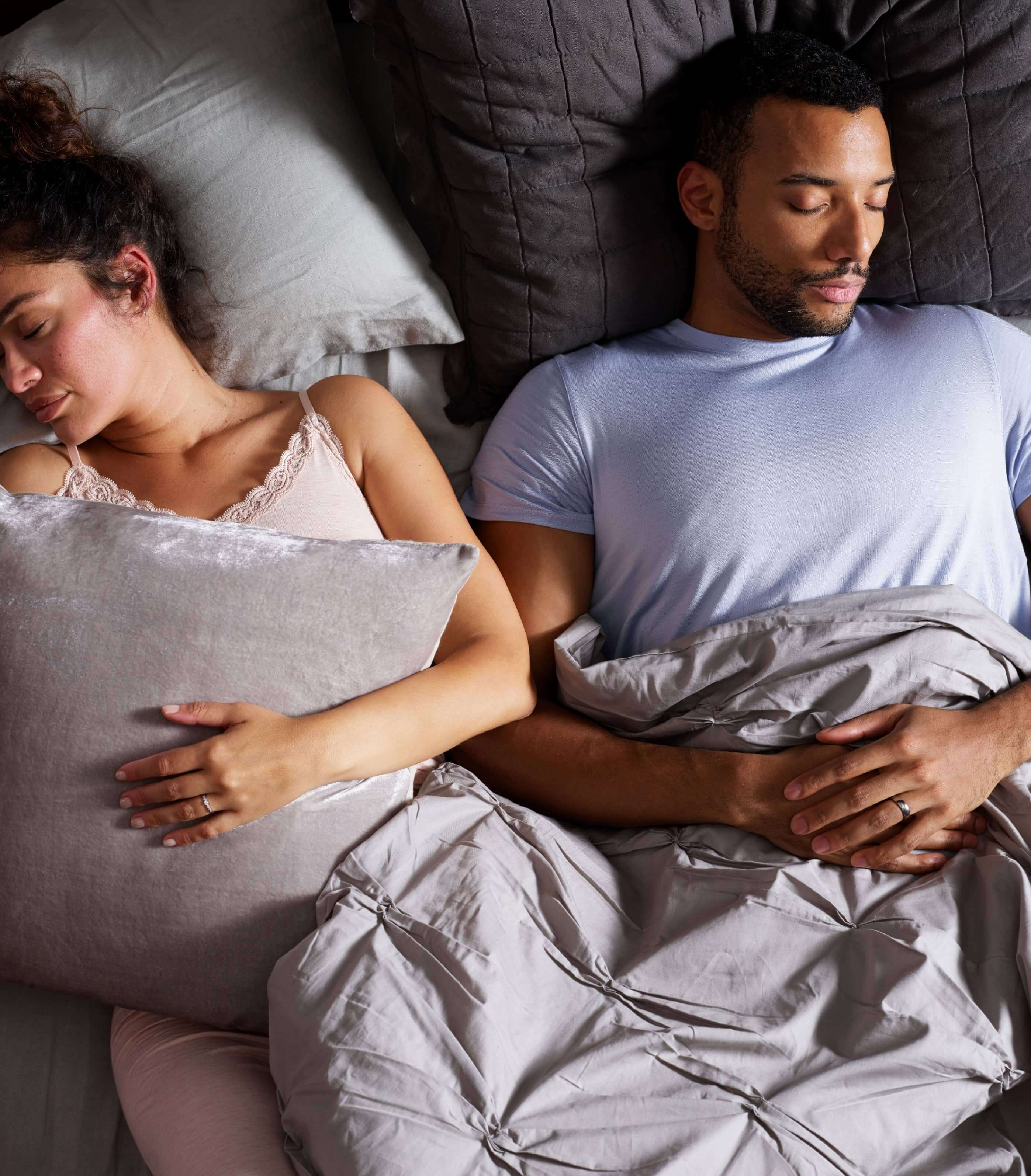 Couple sleeping on a Tempur-Pedic® bed.